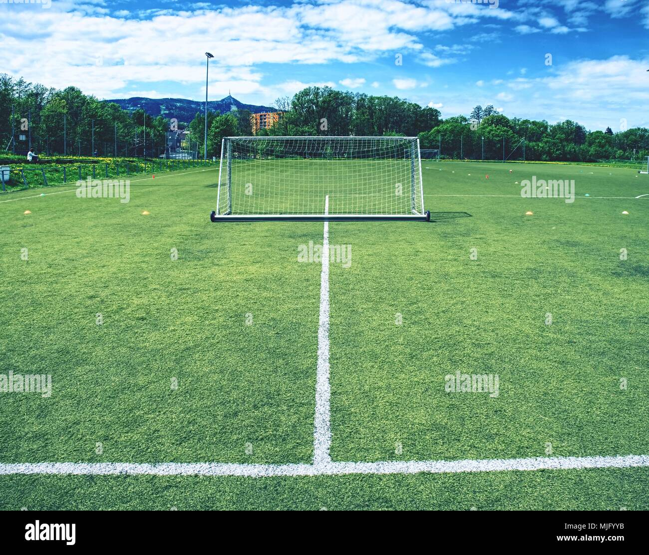 a5c226bbd On football soccer field. Behind goal of soccer field. Soccer football net  background over
