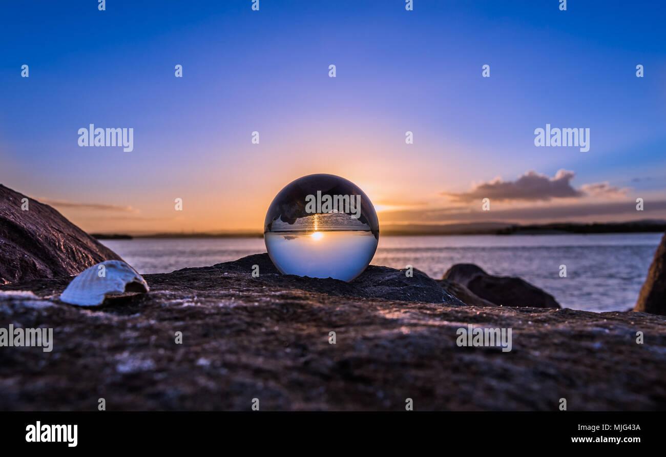 Crystal ball sunset - Stock Image