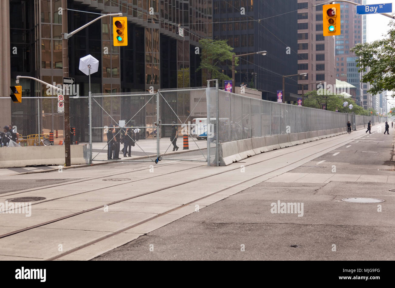 A tall fence surrounds a building along Wellington Street West during the G20 summit in Downtown Toronto, Ontario, Canada. - Stock Image