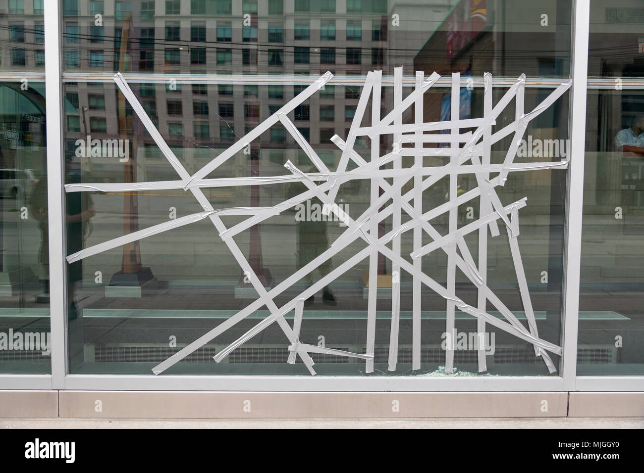 A broken window repaired with duct tape during the G20 summit in Downtown Toronto, Ontario, Canada. - Stock Image