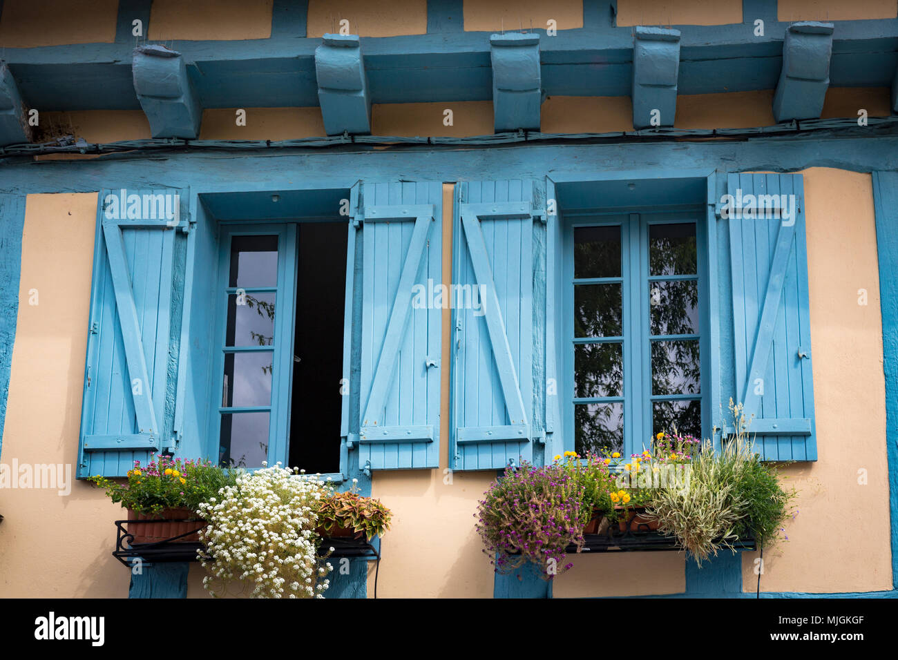 Blue shuttered windows in The medieval town of Josslin in Brittany, France. - Stock Image
