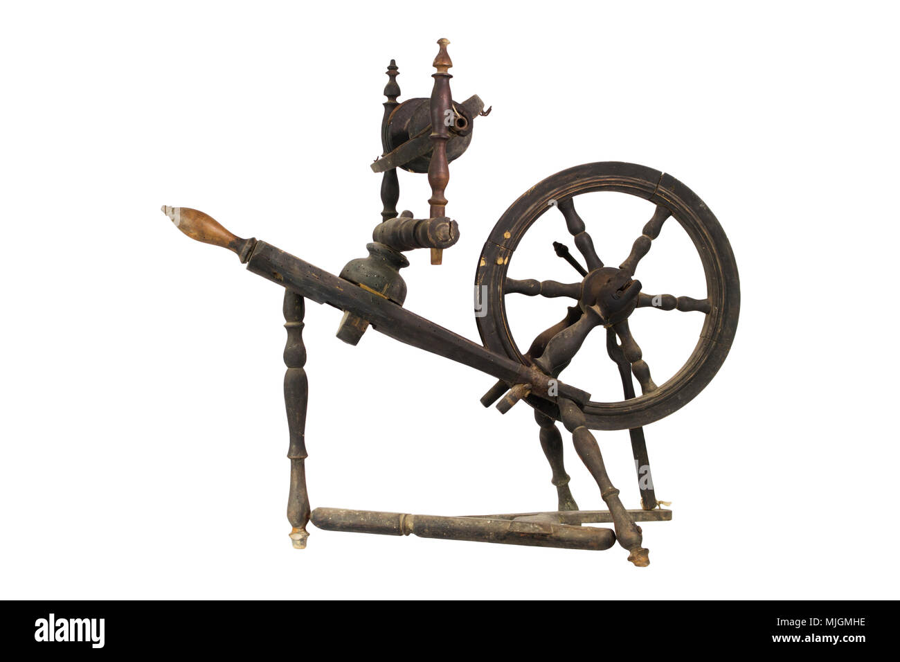 Spinning Wheel For Making Yarn From Wool Fibers. Vintage Rustic Equipment Stock Photo