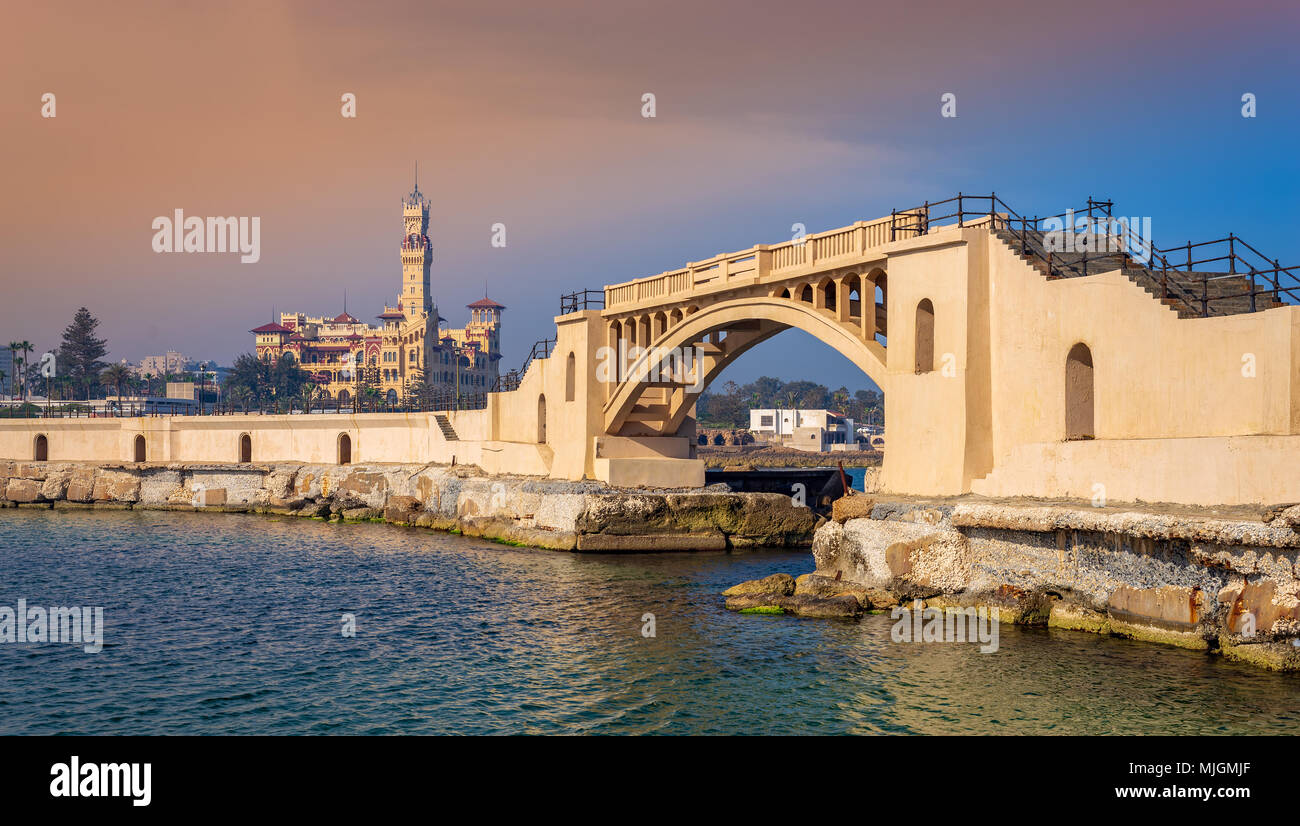 Bridge in the mediterranean sea at the tea island of Montazah park and the Royal palace in the far distance with calm sea at sunrise time, Alexandria, - Stock Image