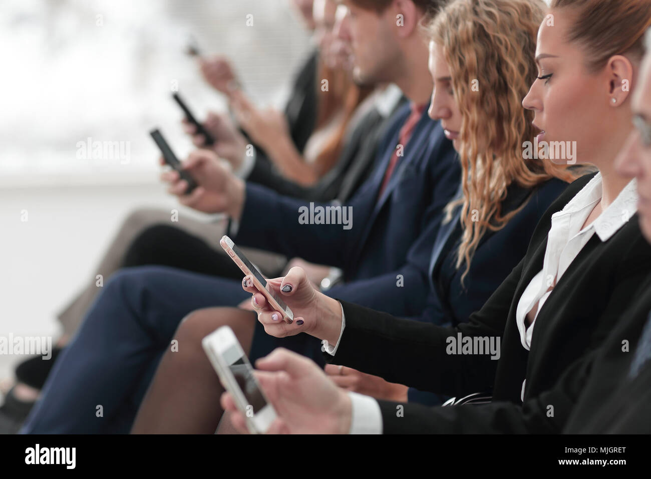 closeup of colleagues sitting at a business conference. - Stock Image