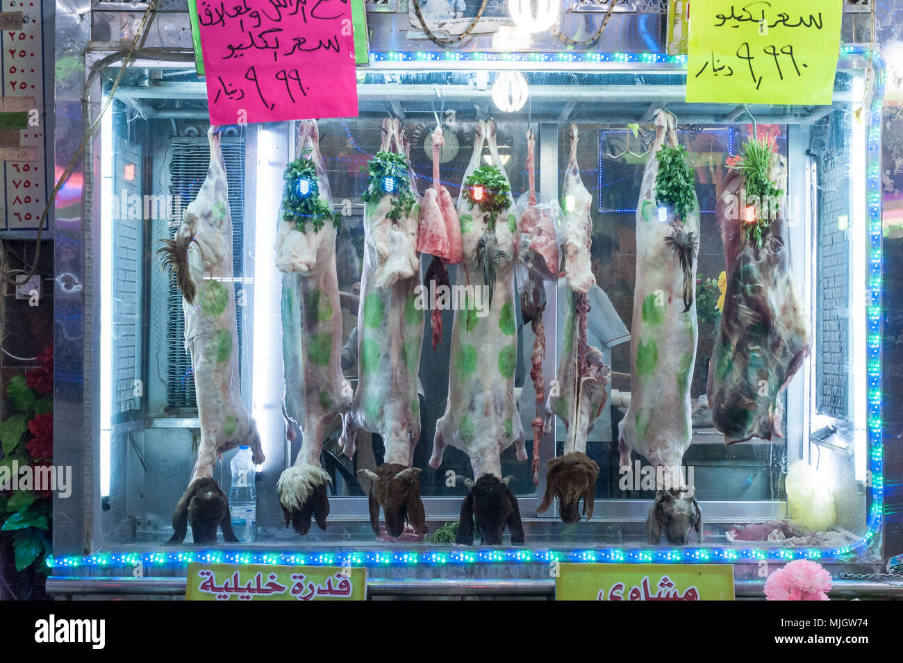 Goats meat at the butcher in Aqaba,al-ʻAqabah, 'the Obstacle' a Jordanian coastal city situated at the northeastern tip of the Red Sea. - Stock Image