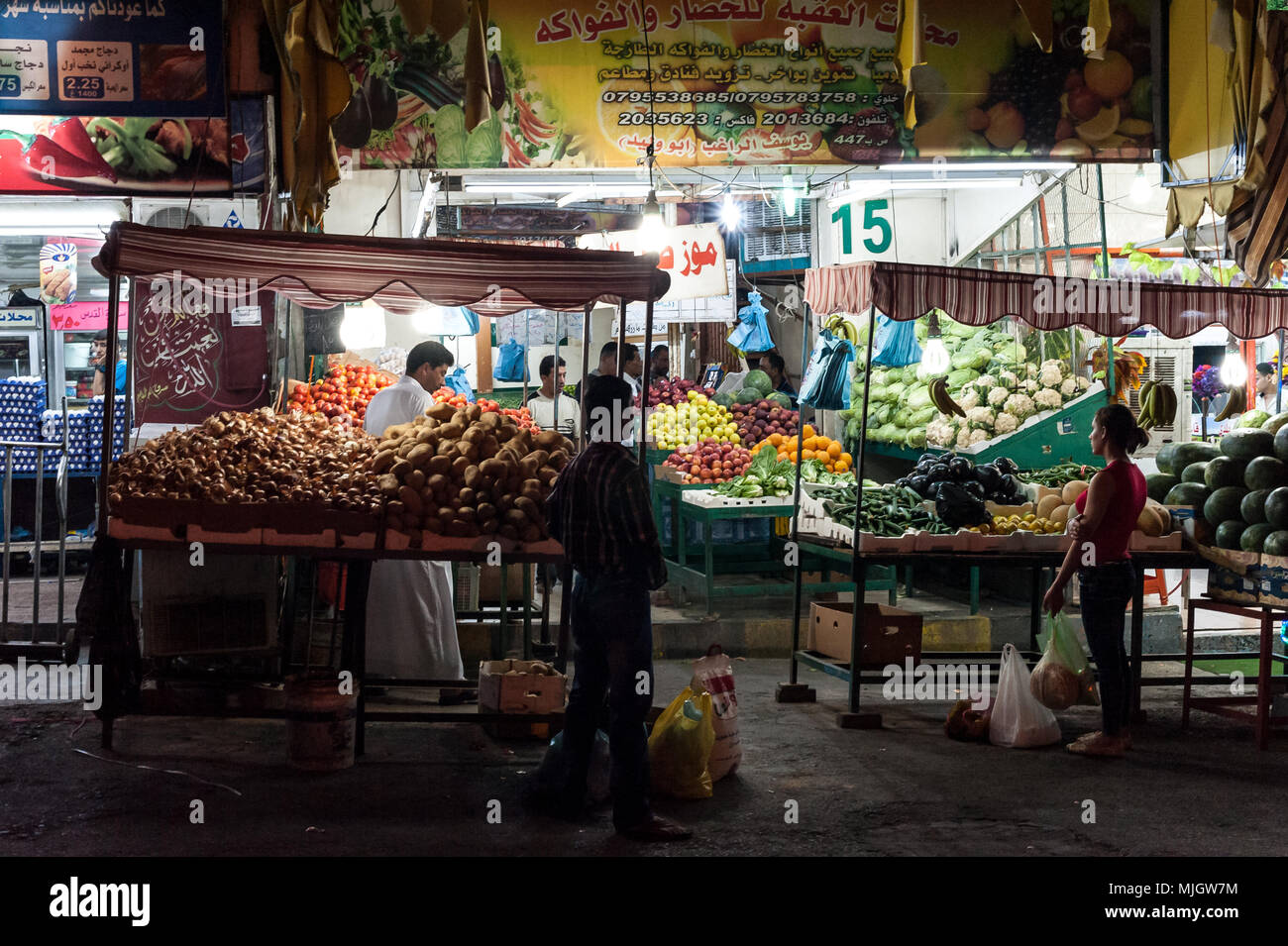 Evening market in Aqaba,al-ʻAqabah, 'the Obstacle' a Jordanian coastal city situated at the northeastern tip of the Red Sea. - Stock Image
