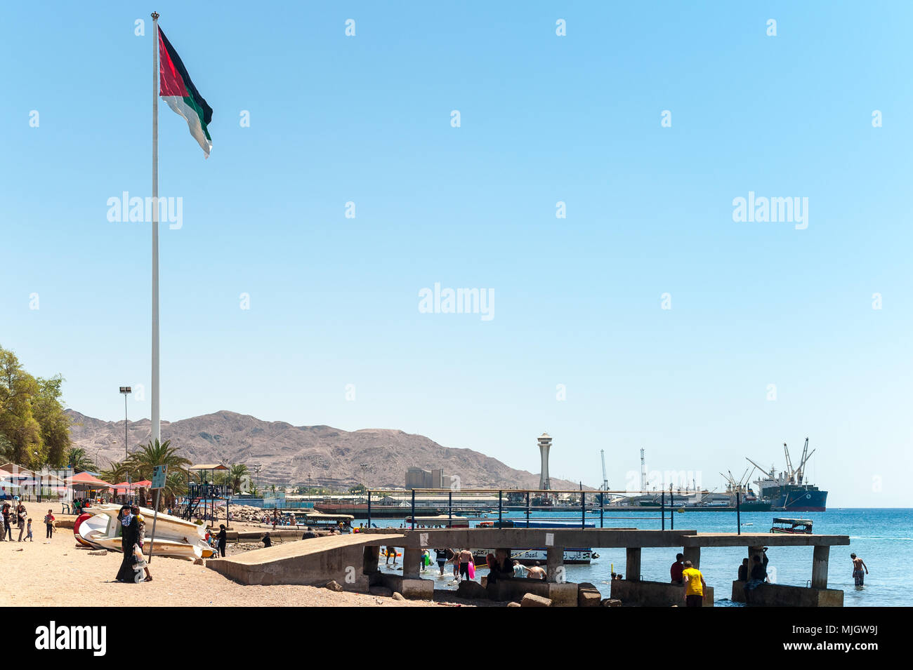 Aqaba,al-ʻAqabah, 'the Obstacle'is a Jordanian coastal city situated at the northeastern tip of the Red Sea. Aqaba is the largest city on the Gulf of - Stock Image