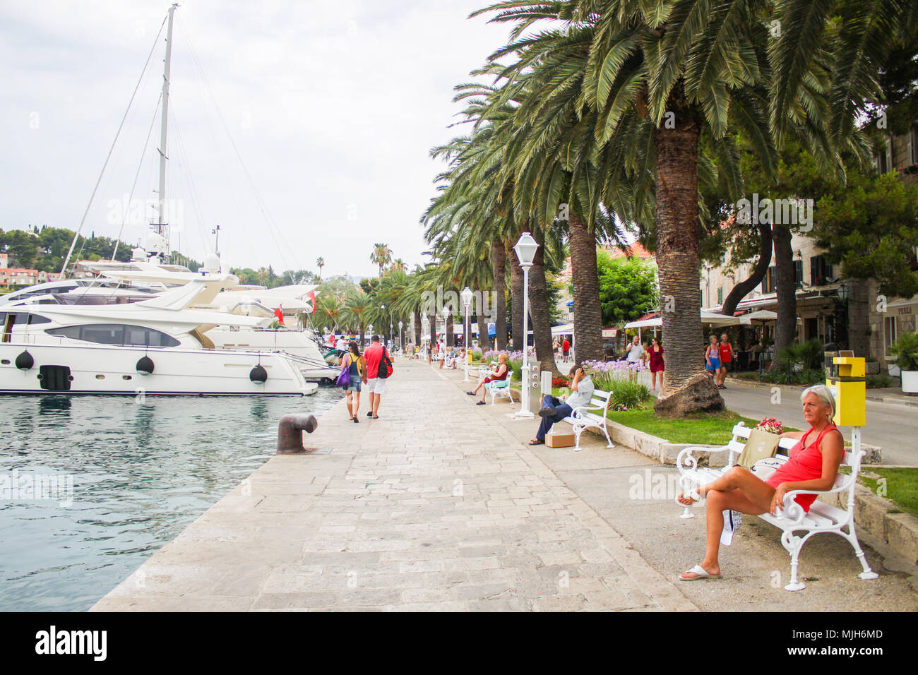 tourists on promenade, harbor cavtat, croatia Stock Photo
