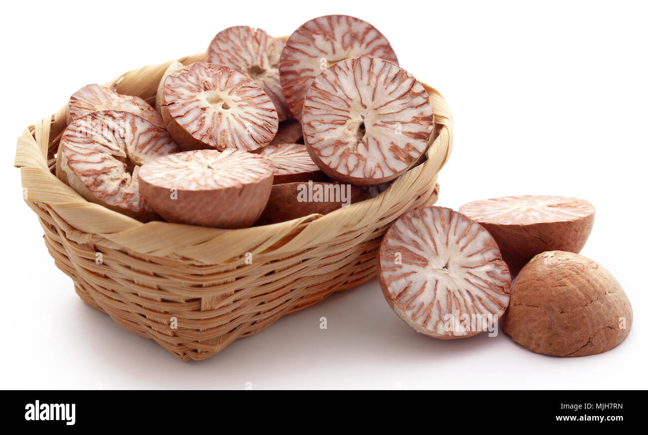 Betel nuts in a basket over white background Stock Photo