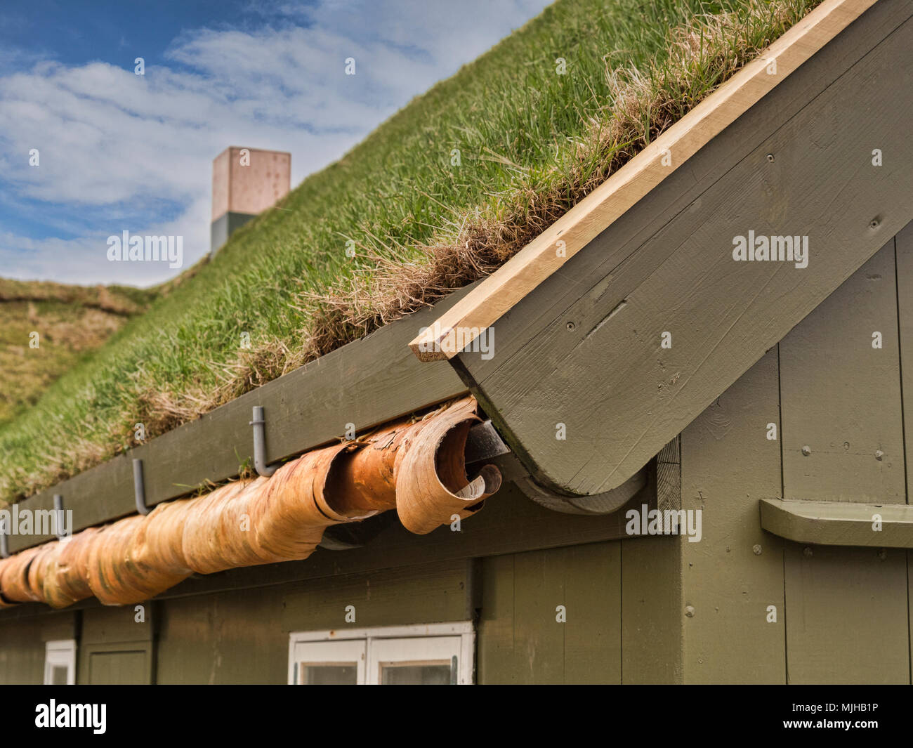 Detail of traditional grass or sod roofed wooden building in Torshavn, Faroe Islands, showing the construction. - Stock Image