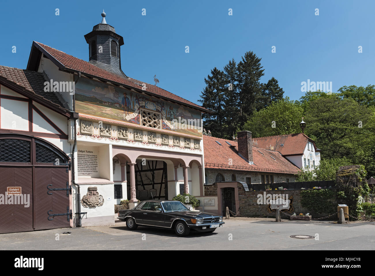 building of the former monastery and today rider court rettershof in the taunus, hesse, germany - Stock Image