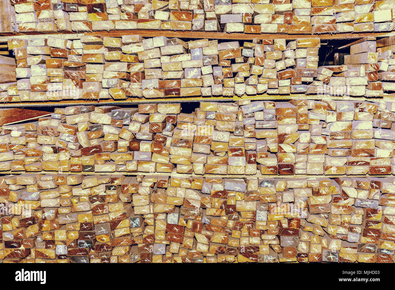 Stacked wood planks at a saw mill for texture background content. - Stock Image
