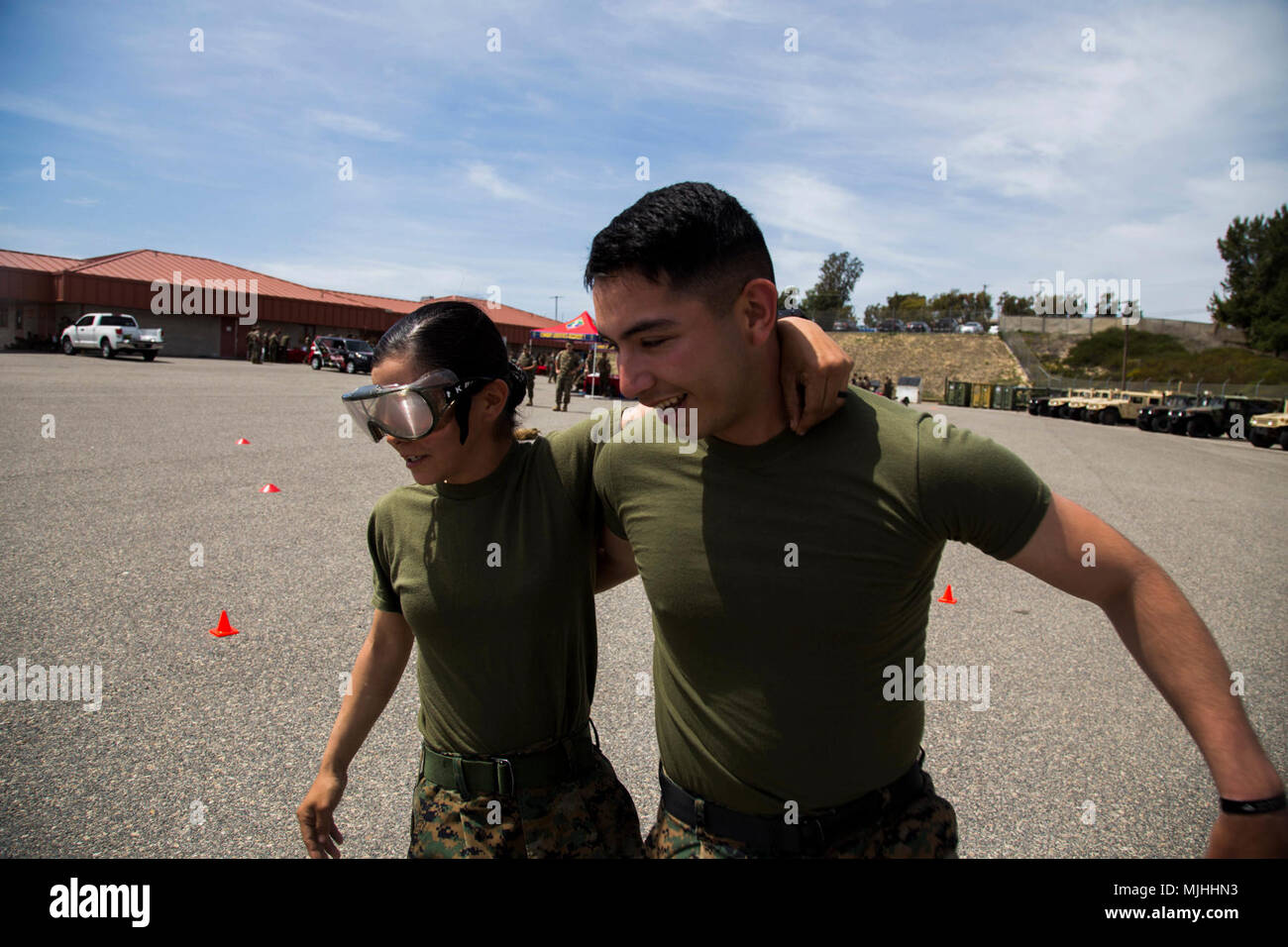 U.S. Marines Cpl. Vanessa, left, and Cpl. Edgar Hernandez, right, both motor transportation operators with Transportation Support Company, Combat Logistics Battalion 1, Combat Logistics Regiment 1, 1st Marine Logistics Group navigating an obstacle course while wearing goggles that simulate the effects of alcohol during the Alcohol Free Weekend event at Camp Pendleton, Calif., April 6, 2018. This is an opportunity to raise awareness of alcohol use throughout CLR-1 and how alcohol may affect Marines, families and the Marine Corps as a whole. (U.S. Marine Corps Stock Photo