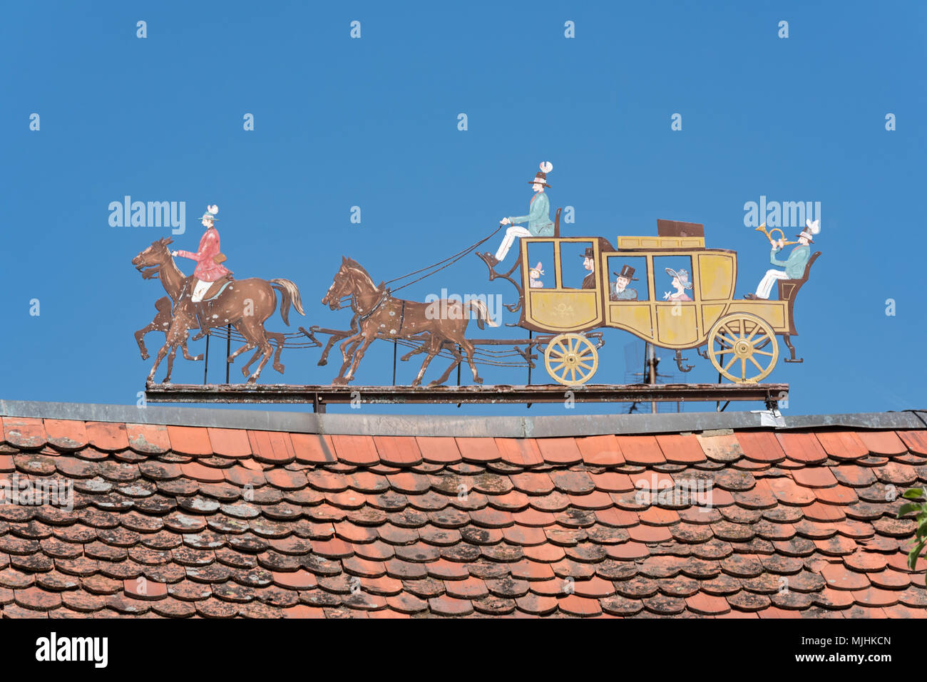 Metal figures stagecoach on the roof of a estate - Stock Image