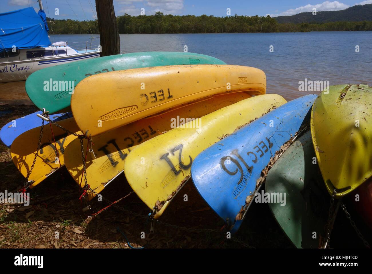 Canoes belonging to Tinaroo Environmental Education Centre on the shores of Lake Tinaroo, Atherton Tablelands, Queensland, Australia. No PR - Stock Image