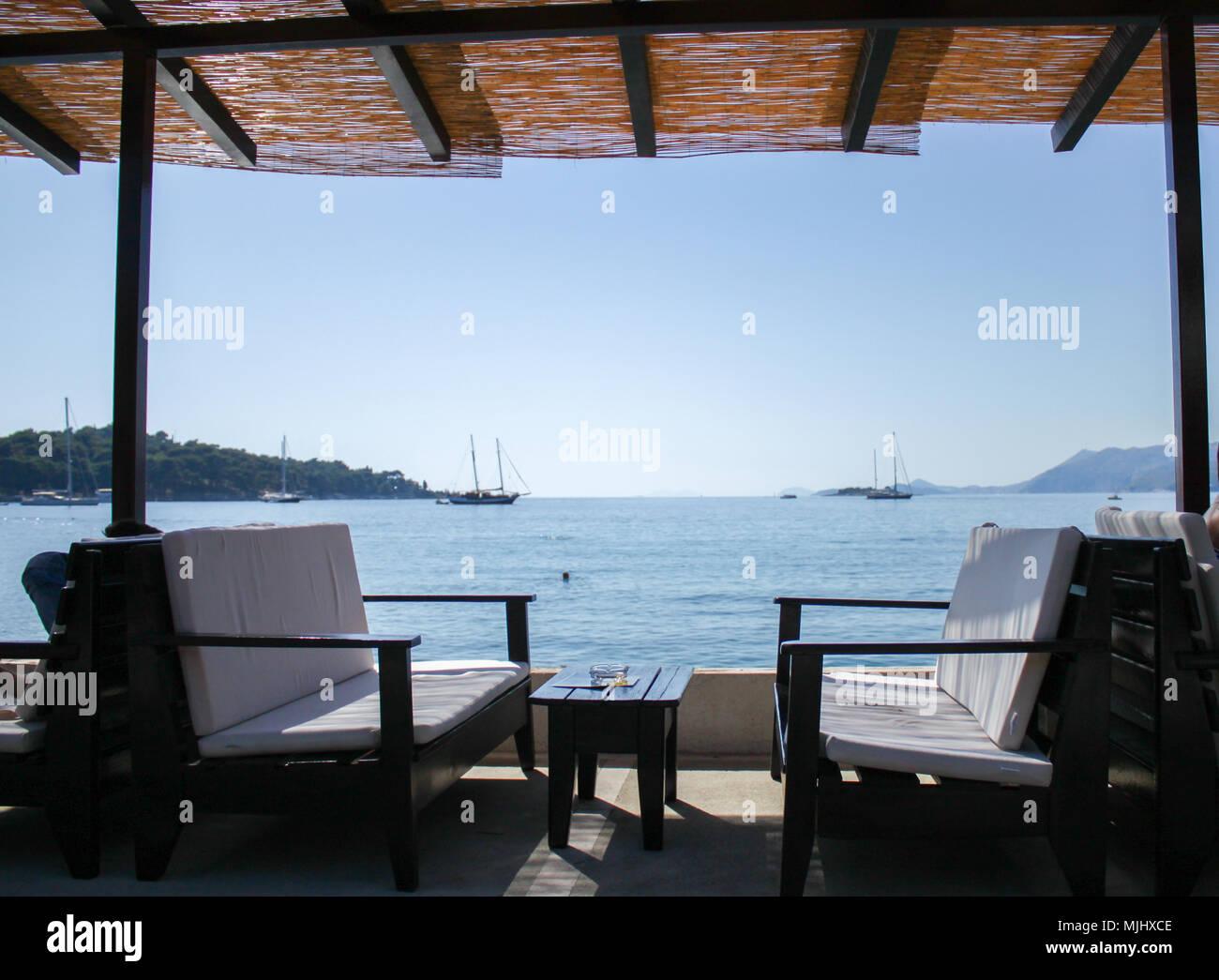 cosy bench on beach bar in cavtat, croatia Stock Photo