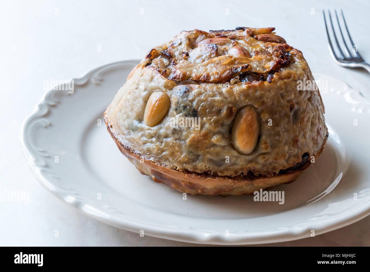 Turkish Perde Pilavi / Drape pilaf with chicken, almond and raisin / Pilav. Traditional Food. - Stock Image