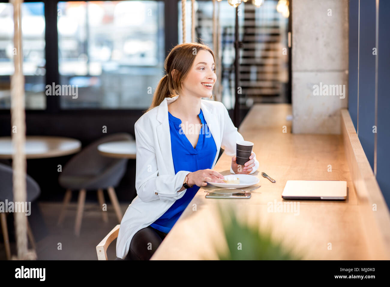 Business woman in the cafe - Stock Image