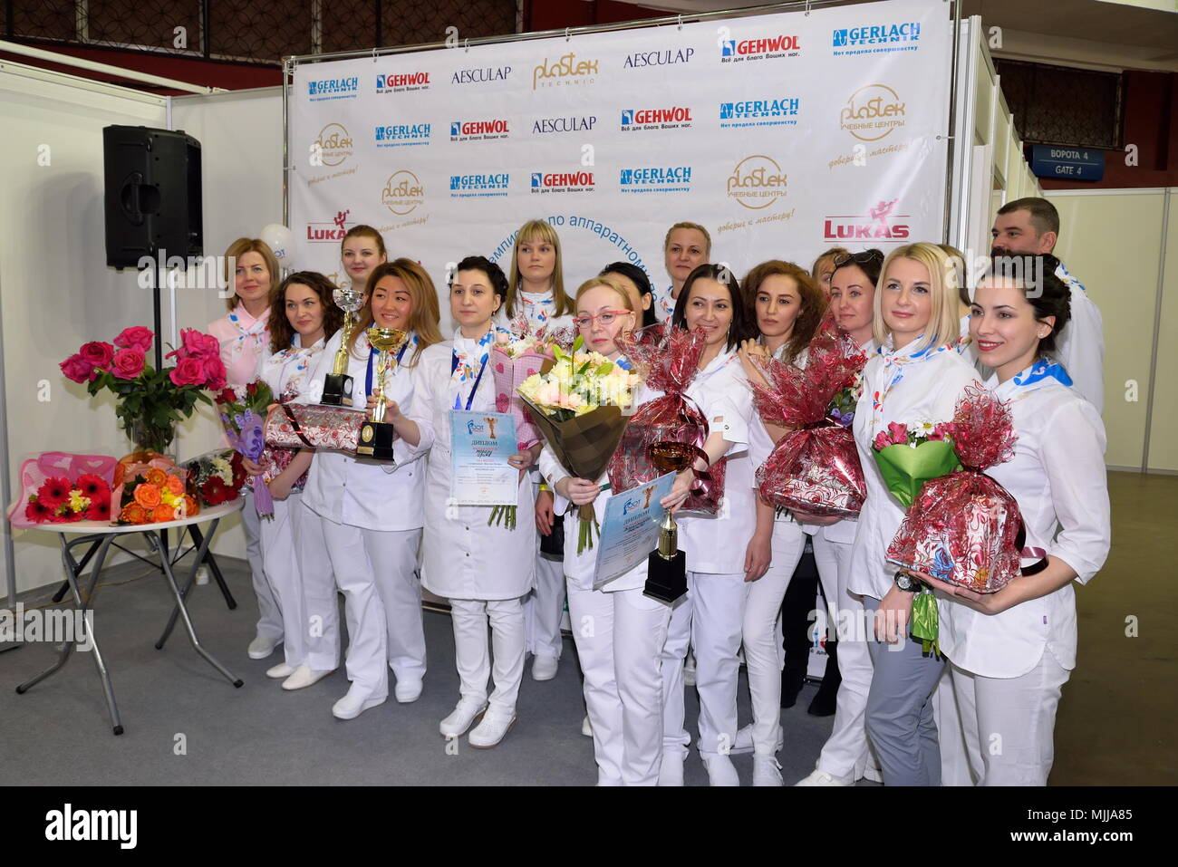 ST.PETERSBURG, RUSSIA - FEBRUARY 23, 2018: Group photo of masters of the championship in apparatus pedicure Foot Profi at the festival of beauty Nevsk - Stock Image