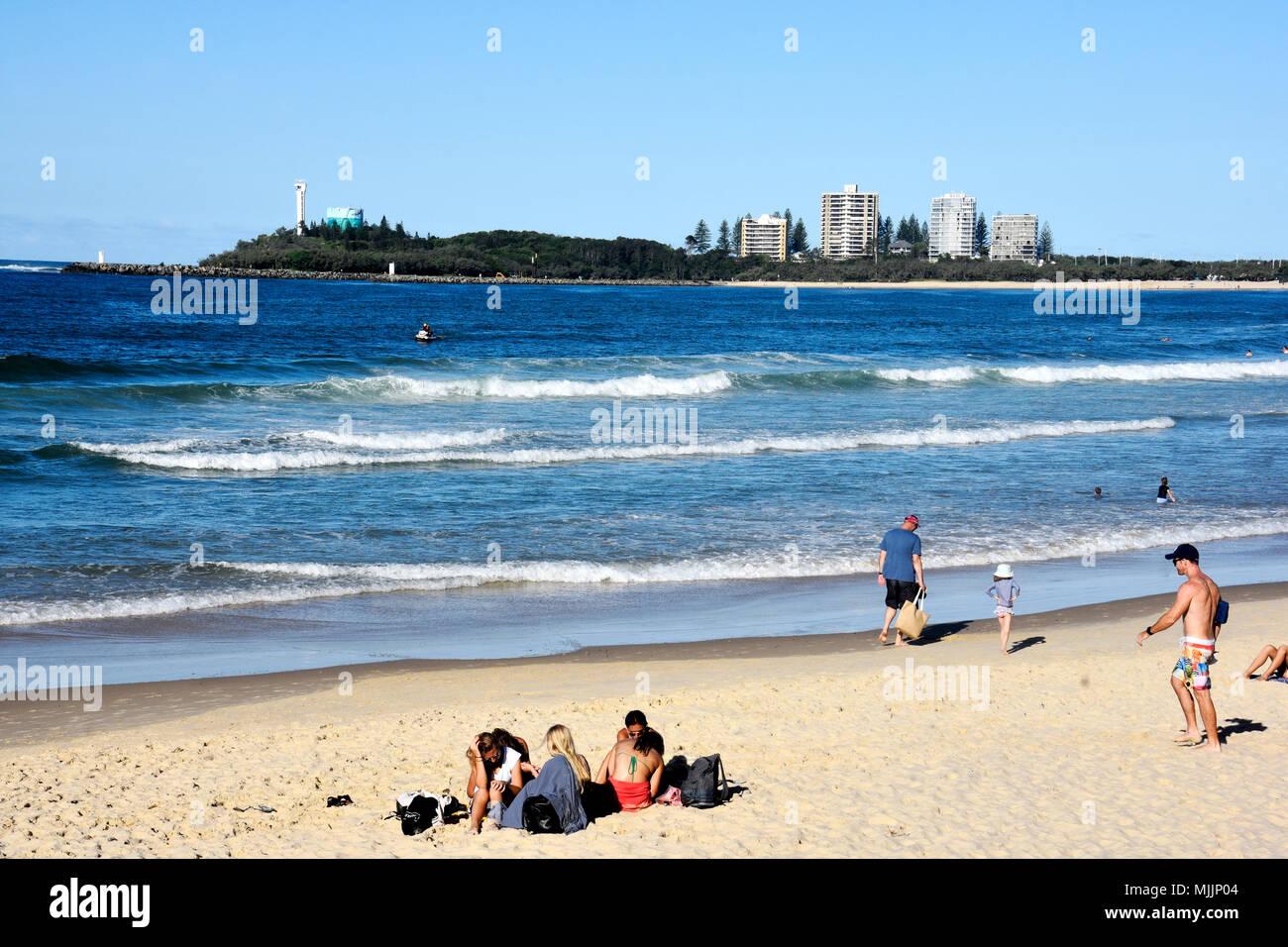 CROWDS OF PEOPLE ENJOYING BEAUTIFUL MOOLOOLABA BEACH IN QUEENSLAND AUSTRALIA Stock Photo