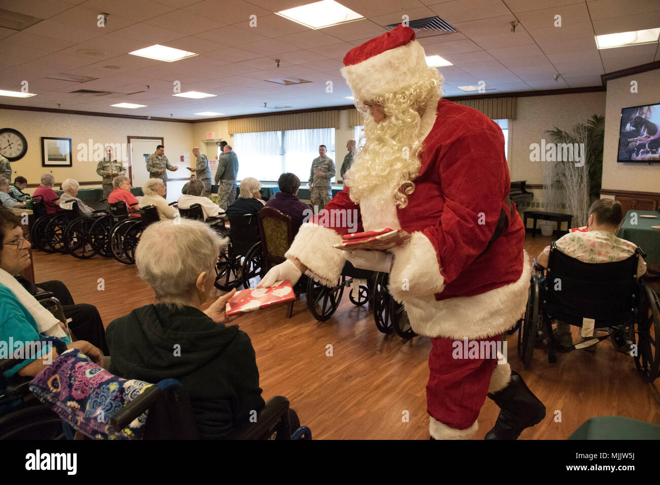airmen with the105th airlift wing hand out gifts and sing christmas carols for the residents visitors and workers of the sapphire nursing home in newburgh
