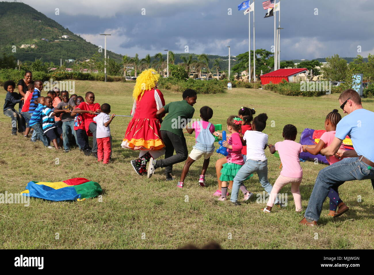 children participate in a game of tug of war during the virgin