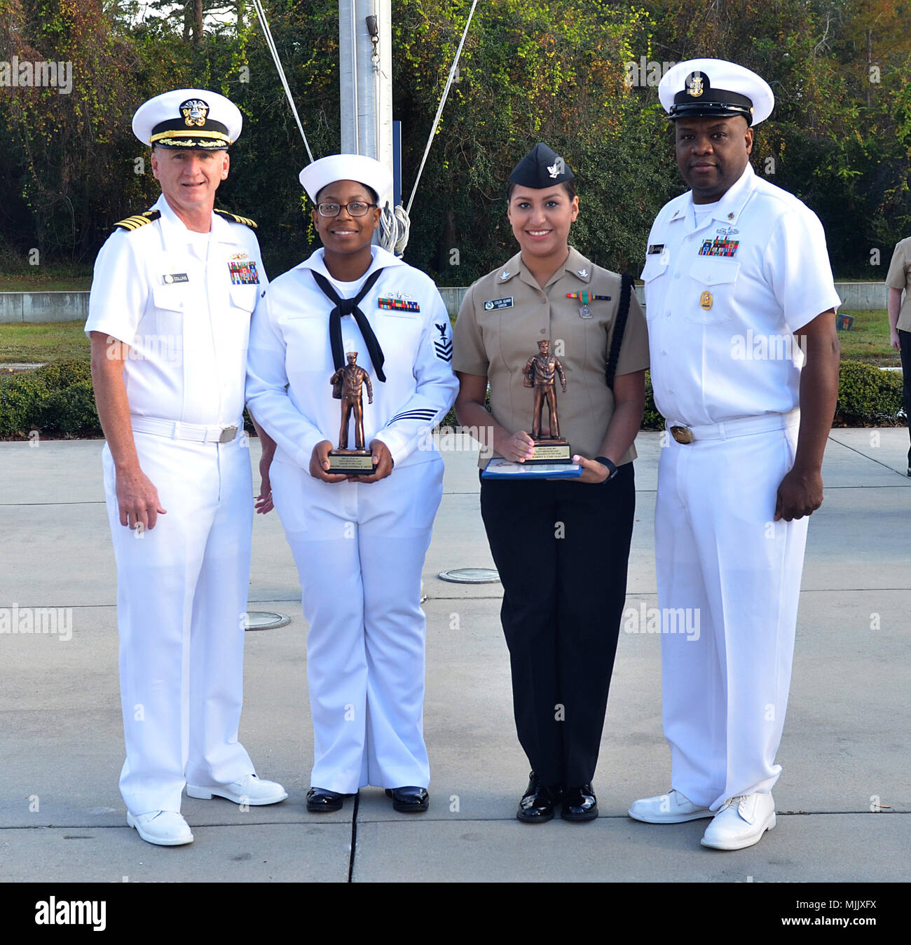 JACKSONVILLE, Fla. (Dec. 1, 2017) – Two Naval Hospital Jacksonville sailors have been selected by Navy Medicine East as Regional Sailors of the Year. HM1 Alexanderia Artis (center, left) is the NME Senior Sailor of the Year and HN Karina GarciaAlanis (center, right) is the NME Blue Jacket Sailor of the Year. Sailors from across NME's 21 commands in the eastern hemisphere competed. Also pictured are Capt. David Collins (left), Naval Hospital Jacksonville commanding officer, and Naval Hospital Jacksonville Command Master Chief Lewis Jackson. (U.S. Navy photo by Yan Kennon, Naval Hospital Jackson Stock Photo