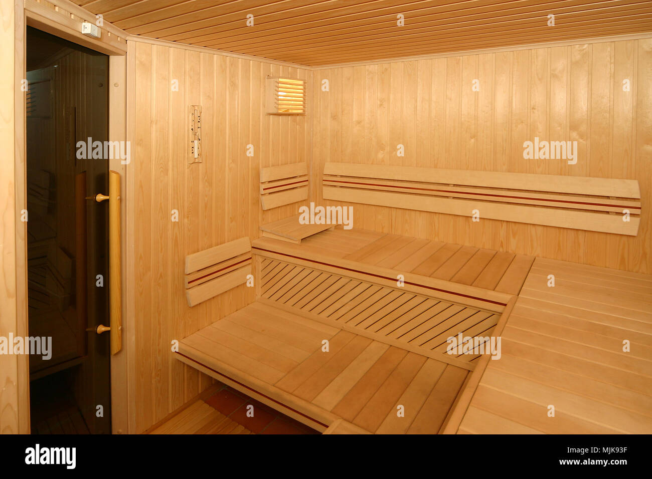 Sauna room with traditional sauna accessories - Stock Image