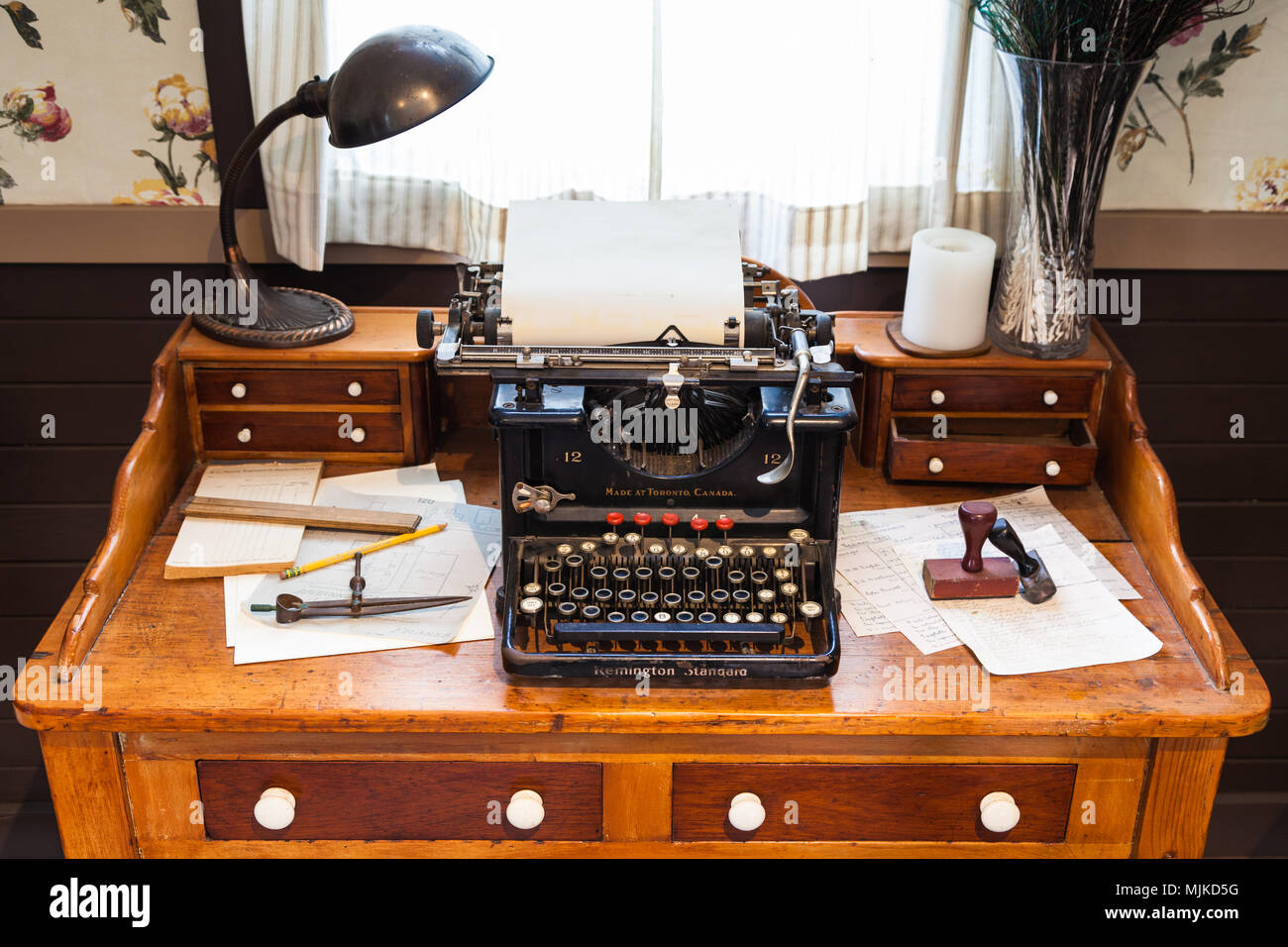 Antique Remington typewriter on an old wooden desk - Antique Remington Typewriter On An Old Wooden Desk Stock Photo