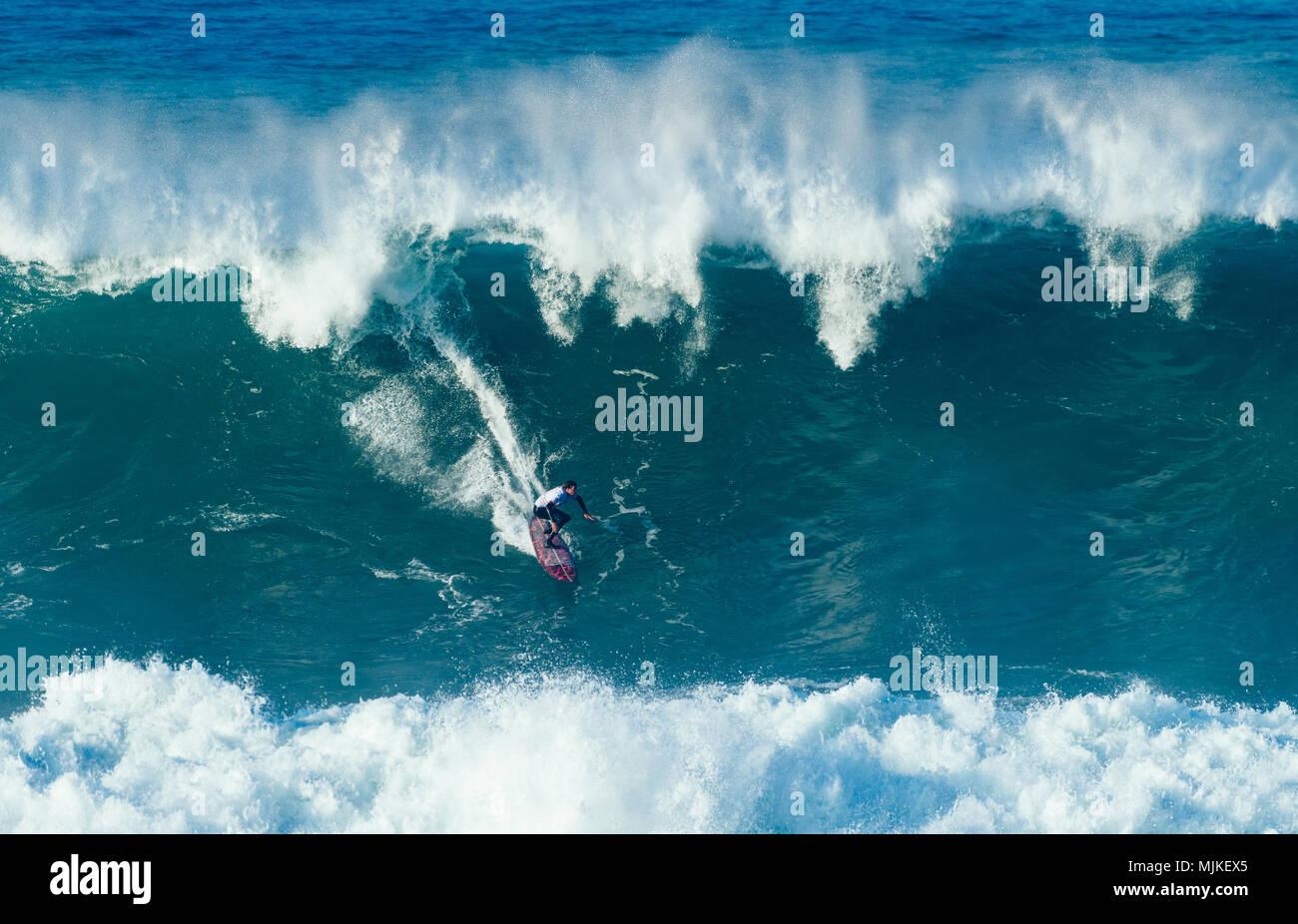 Surfer on a big wave - Stock Image