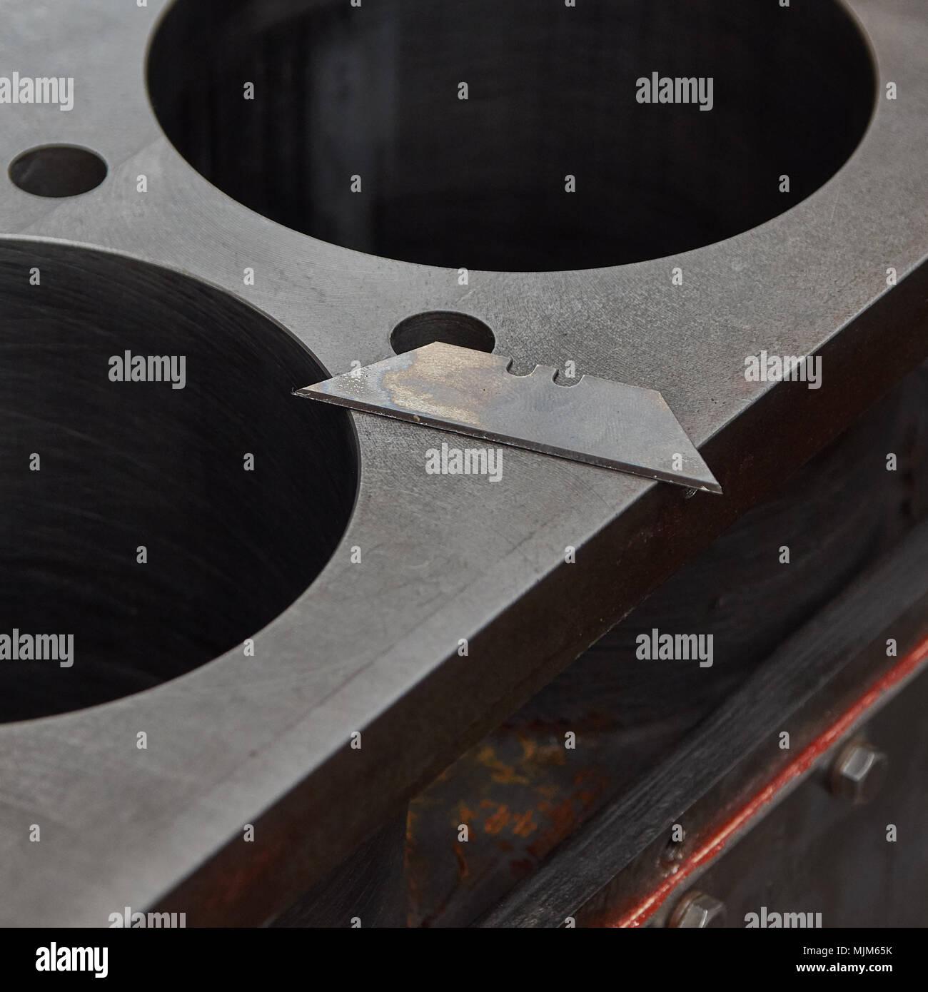 Blade on cylinder head block - Stock Image