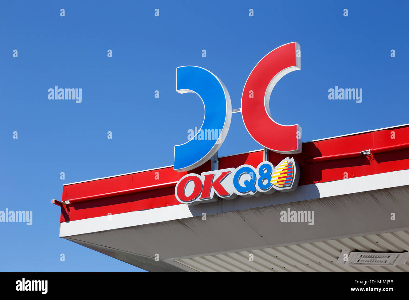 Ornskoldsvik, Sweden - June 29, 2017: The roof above the gasoline service station OKQ8 with a close-up of the brand name and logo. - Stock Image