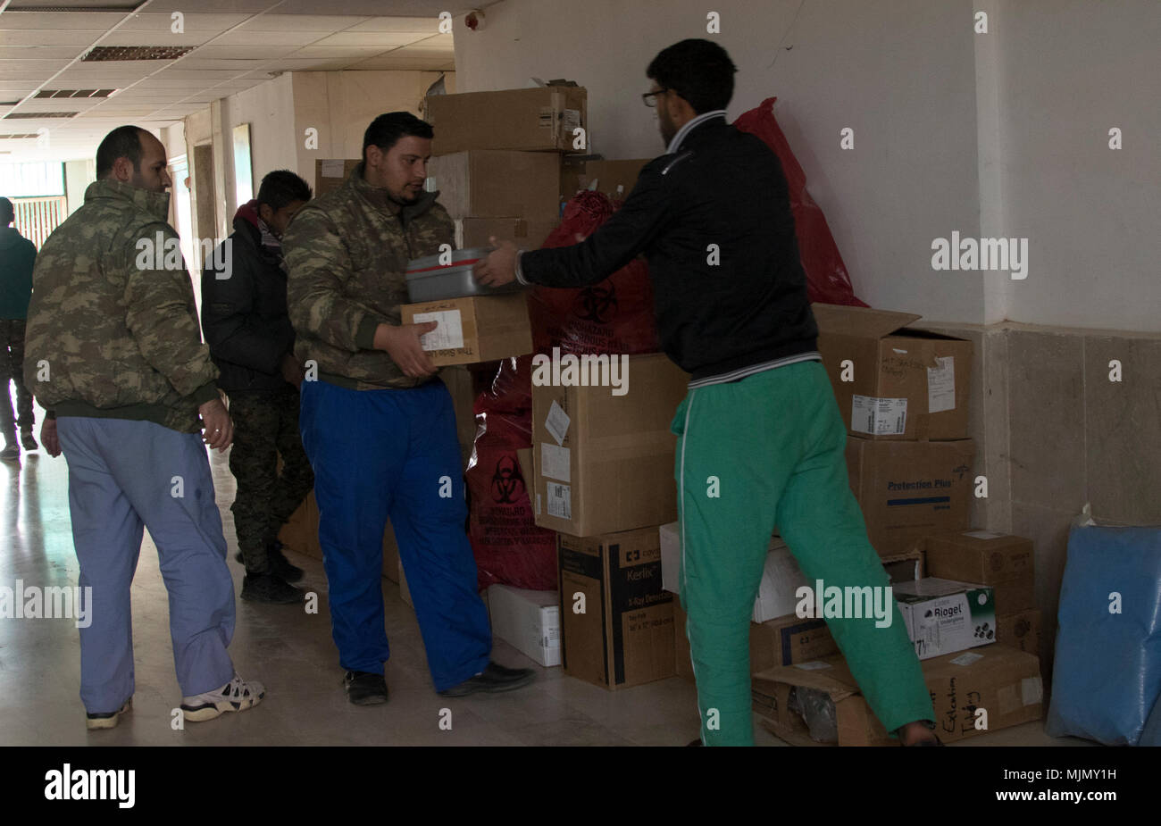low priced 1fe47 b792a A truck carrying medical supplies from the civilian hospital in Al Hasakah  city is unloaded by ...