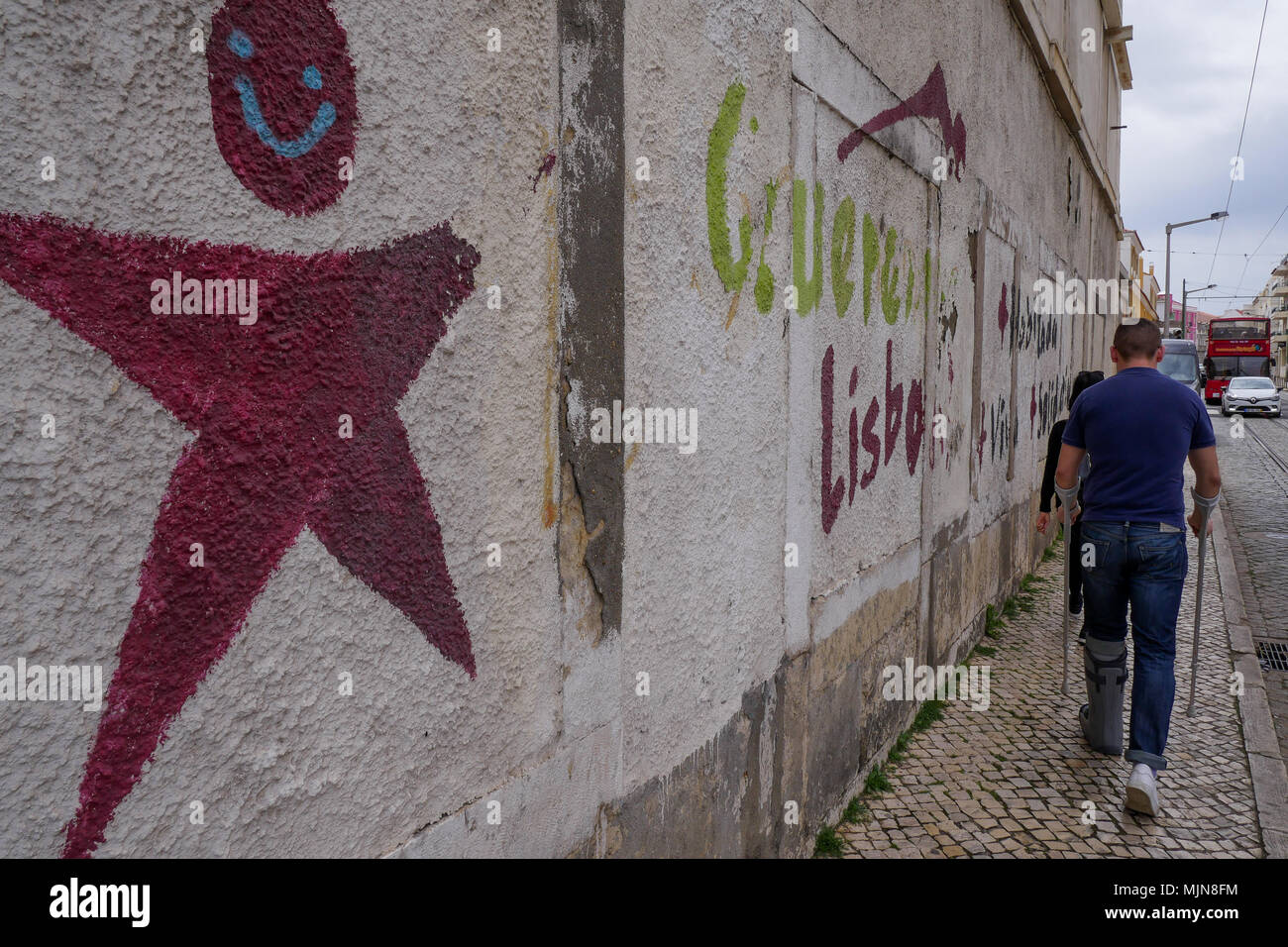 Street view with colored grffiris, Belem district, Lisbon, Portugal - Stock Image
