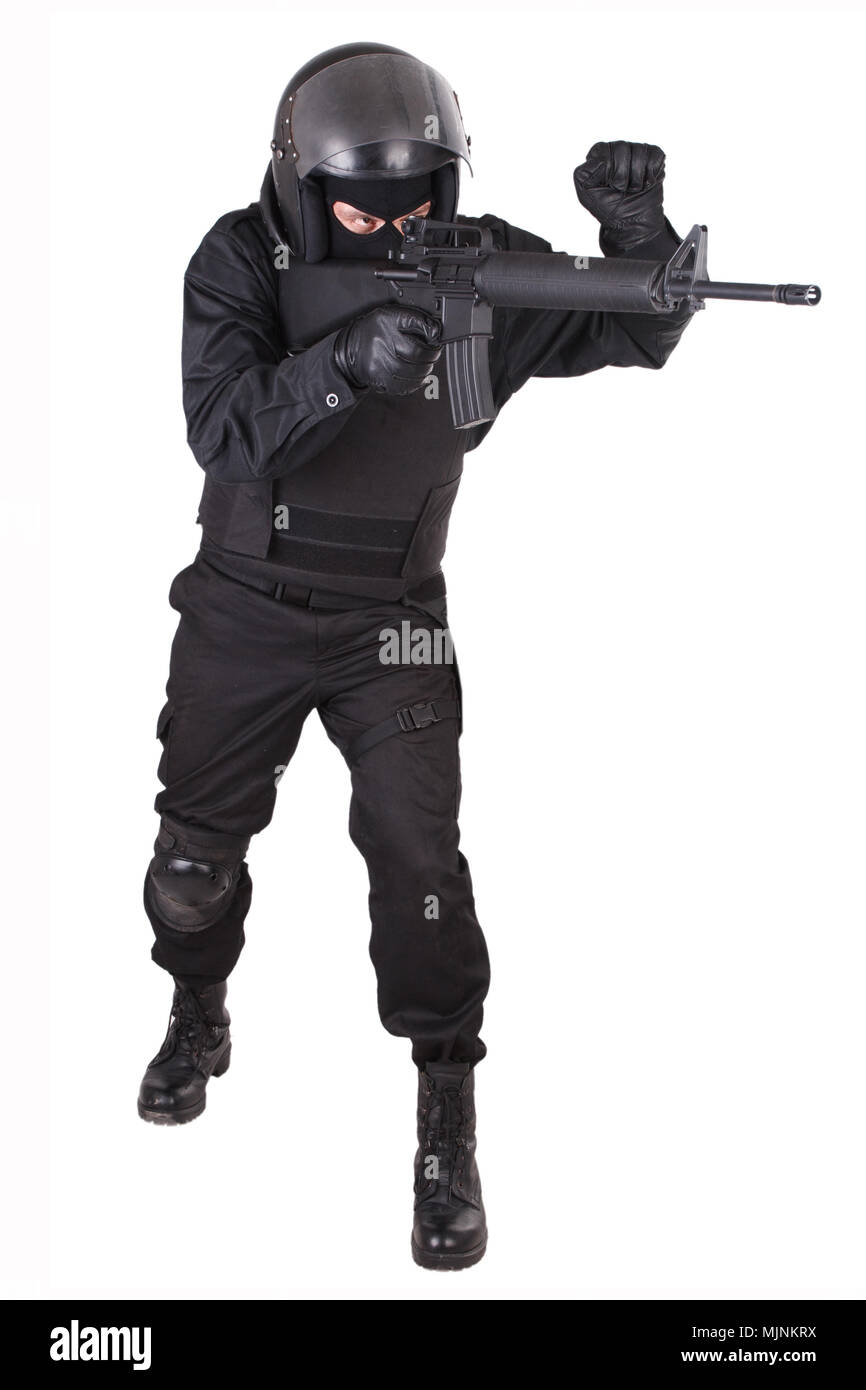 Riot police officer with weapon in black uniform isolated on white Stock Photo