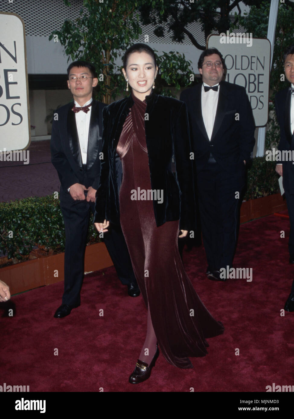 Gong Li --- ' Tsuni / USA 'Gong Li Gong Li Celebrities fashion / Full length from the Red Carpet-1994-2000, one person, Vertical, Best of, Hollywood Life, one person, Vertical, Best of, Hollywood Life, Event in Hollywood Life - California,  Red Carpet Event, Vertical, USA, Film Industry, Celebrities,  Photography, Bestof, Arts Culture and Entertainment, , , Topix - Stock Image