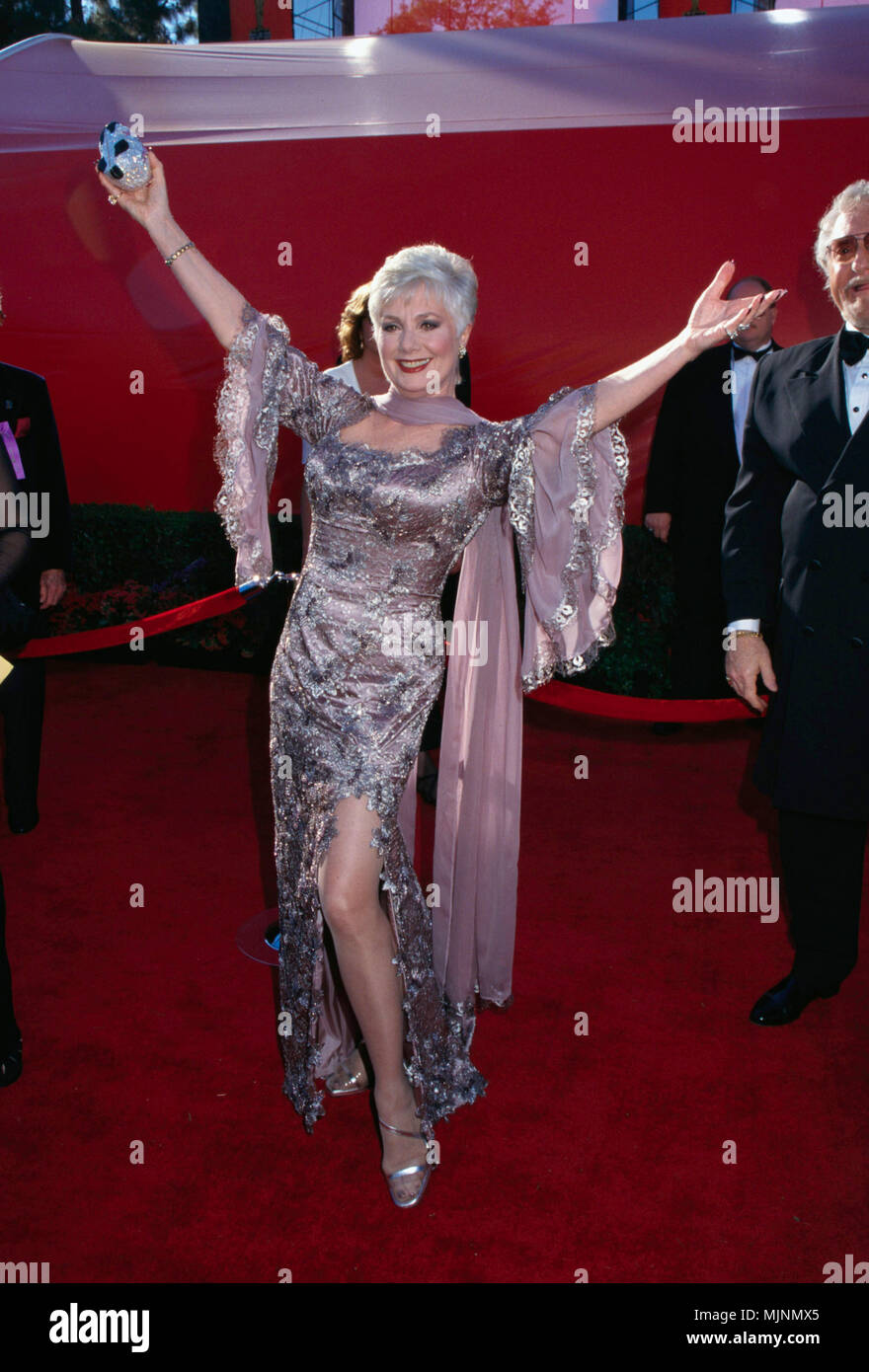 678337a6e81 1998 --- Shirley Jones shows off her gown at the 1998 Academy Awards  accompanied