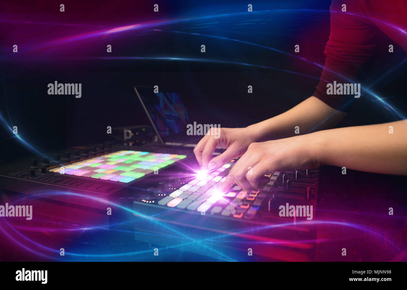 Hand mixing music on djcontroller with wave vibe concept - Stock Image