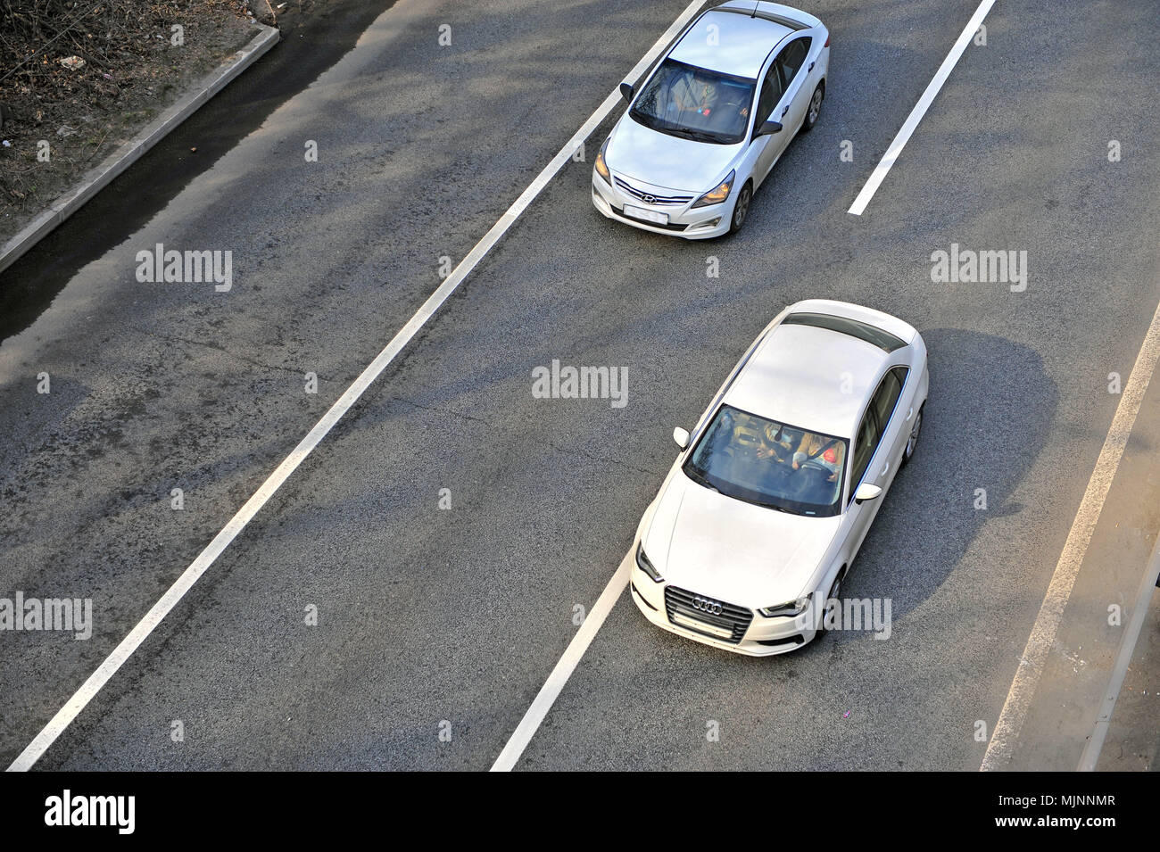 MOSCOW, RUSSIA - APRIL 30: Top view of two cars on highway