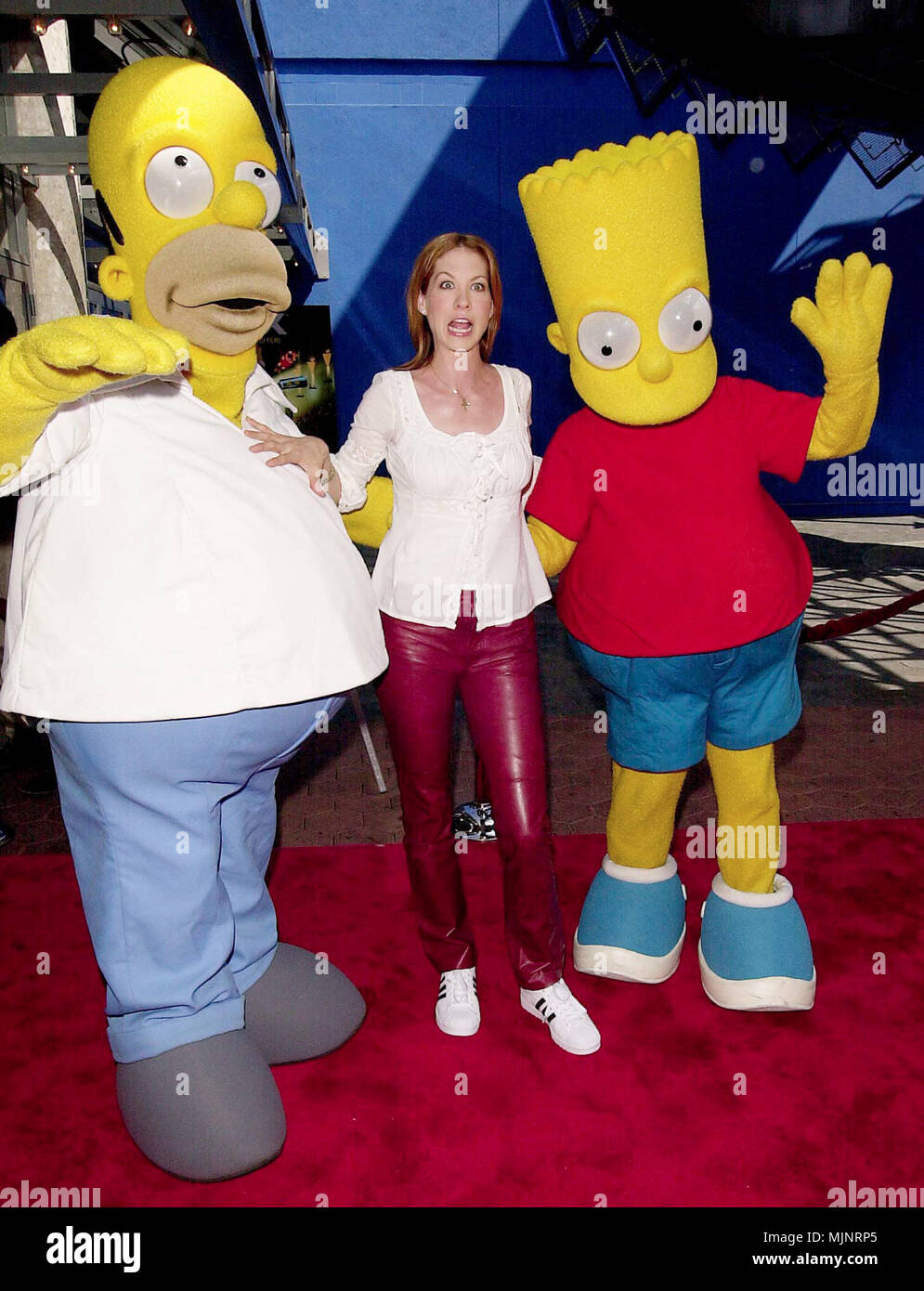 01 Oct 2000, Los Angeles, California, USA --- Homer Simpson, Jenna Elfman and Bart Simpson at the 3 Dimensions Imax Feature of the animated 'Cyberworld 3D'. 10.1.00-Los Angeles, CA --- ' Tsuni / USA 'Homer Simpson, Jenna Elfman and Bart Simpson Homer Simpson, Jenna Elfman and Bart Simpson inquiry tsuni@Gamma-USA.com - Stock Image
