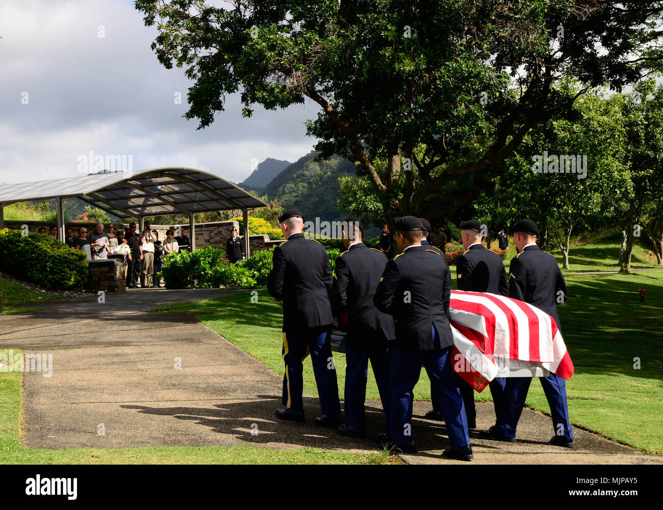 U.S. Soldiers assigned to 225th Brigade Support Battalion, 2nd Infantry Brigade Combat Team, 25th Infantry Division escort the remains of U.S. Army Pfc. Albert E. Atkins, Dec. 15, 2017, in the National Memorial Cemetery of the Pacific, Honolulu, Hawaii. On May 23, 1951, Atkins, a member of Company E, 2nd Battalion, 187th Airborne Infantry Regiment, 187th Airborne Regimental Combat Team, engaged enemy forces with his unit near Mae-Bong, South Korea. Atkins and two other soldiers from his company were reported missing in action. Atkins was recently identified through DNA analysis with the help o - Stock Image