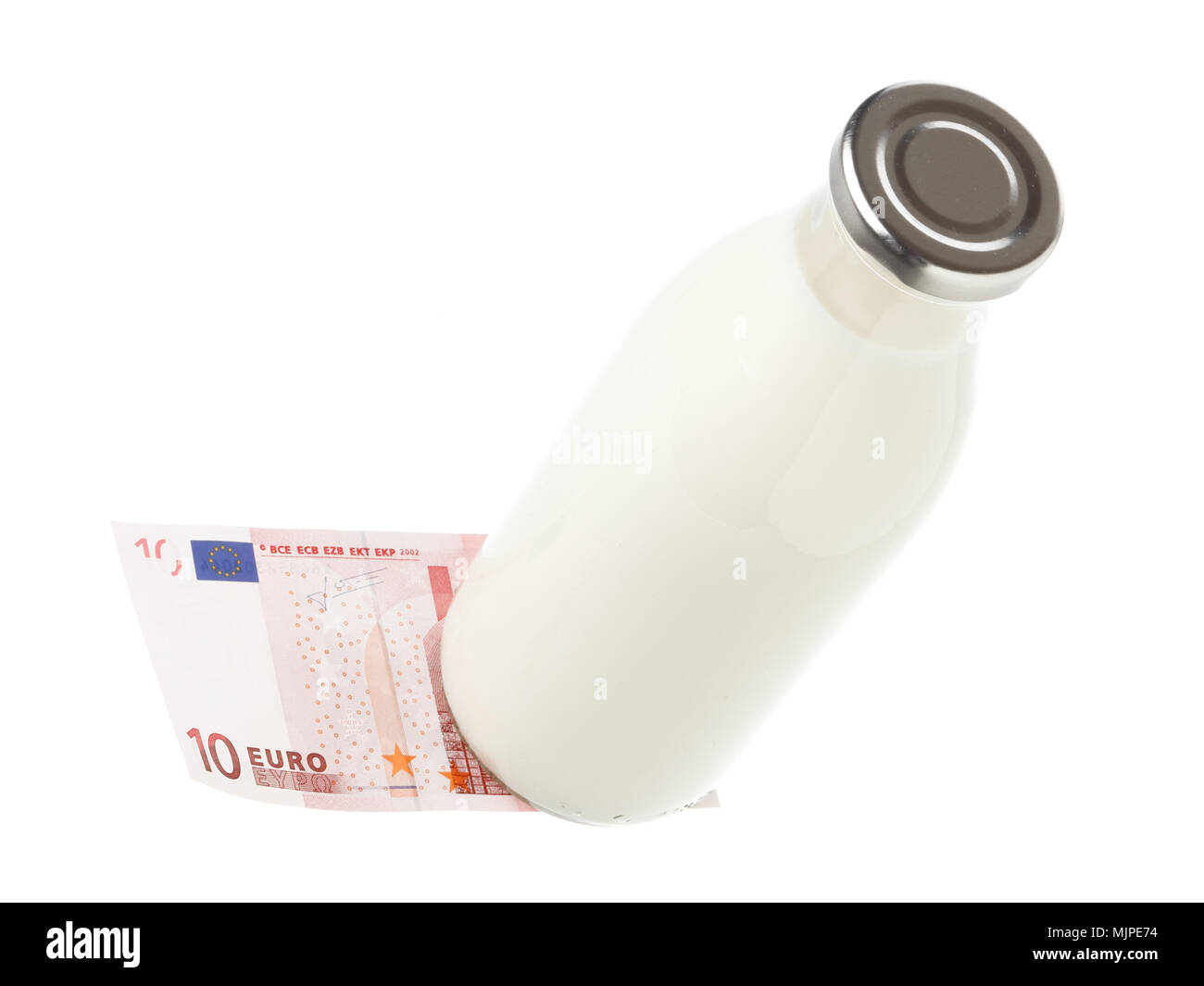 One classic full milk bottleon an ten Euro banknote isolated on white. - Stock Image