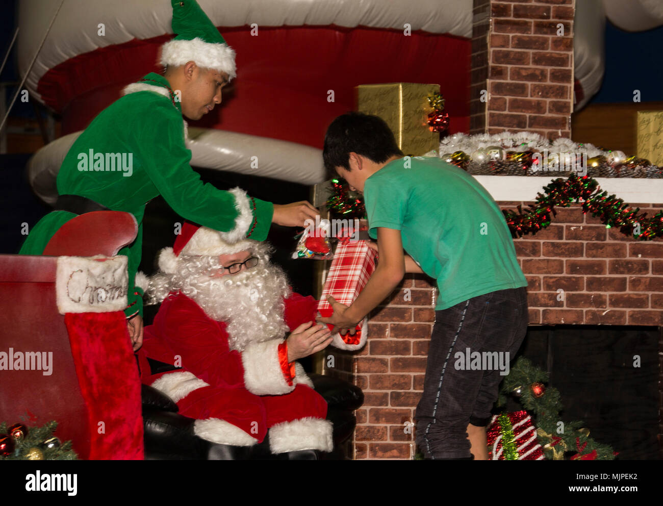 Santa Claus and his elves present gifts to children from Yahata ...
