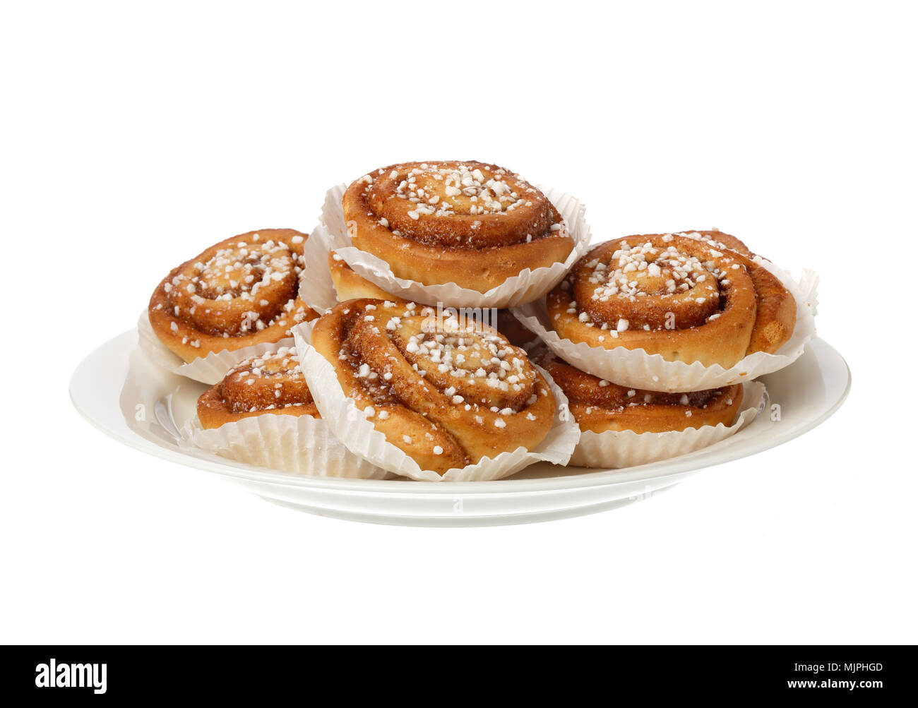 Cinnamon rolls in tins of grceaseproo fpaper isolated on white. - Stock Image