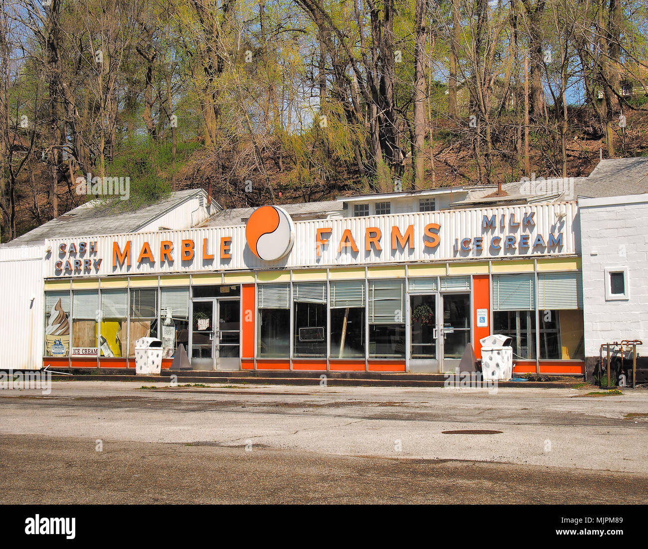 Syracuse, New York, USA. May 5, 2018. Marble Farms , a popular cash and carry and ice cream shop for over 75 years ,closed in the 1990's , but remains - Stock Image