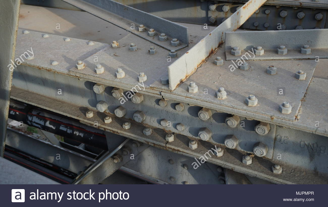 bolts of a gray painted metal bridge in detail Stock Photo