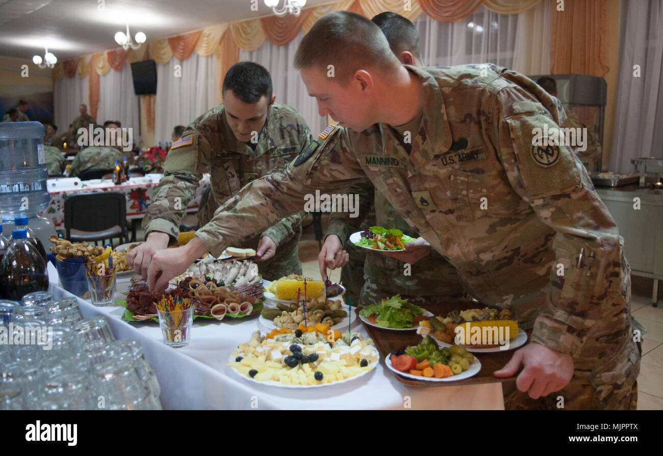 Yavoriv, Ukraine – 27th Infantry Brigade Combat Team Soldiers assigned to the Joint Multinational Training Group – Ukraine host a Christmas dinner at the Yavoriv Combat Training Center near Yavoriv, Ukraine. Currently more than 220 of the Brigade's Soldiers are deployed overseas working alongside the Ukrainian Army. (U.S. Army photo by Sgt. Alexander Rector) Stock Photo