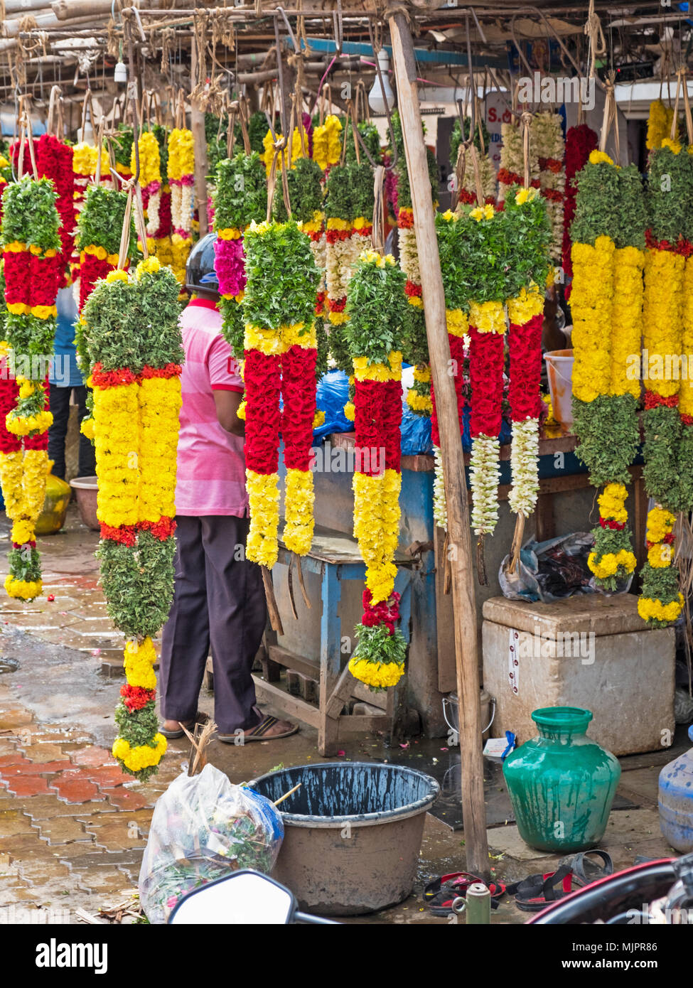 Garlands for sale in a street market in Tamil Nadu, India. They are widely used for dedications in Hindu rituals and for decoration at festivals - Stock Image
