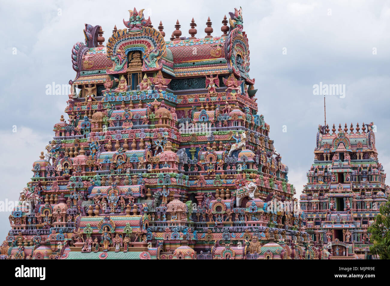 Two of the intricately carved and painted entrance gateways, or Gopurams, at the Ranganathaswamy temple at Srirangam at Trichy in Tamil Nadu Stock Photo