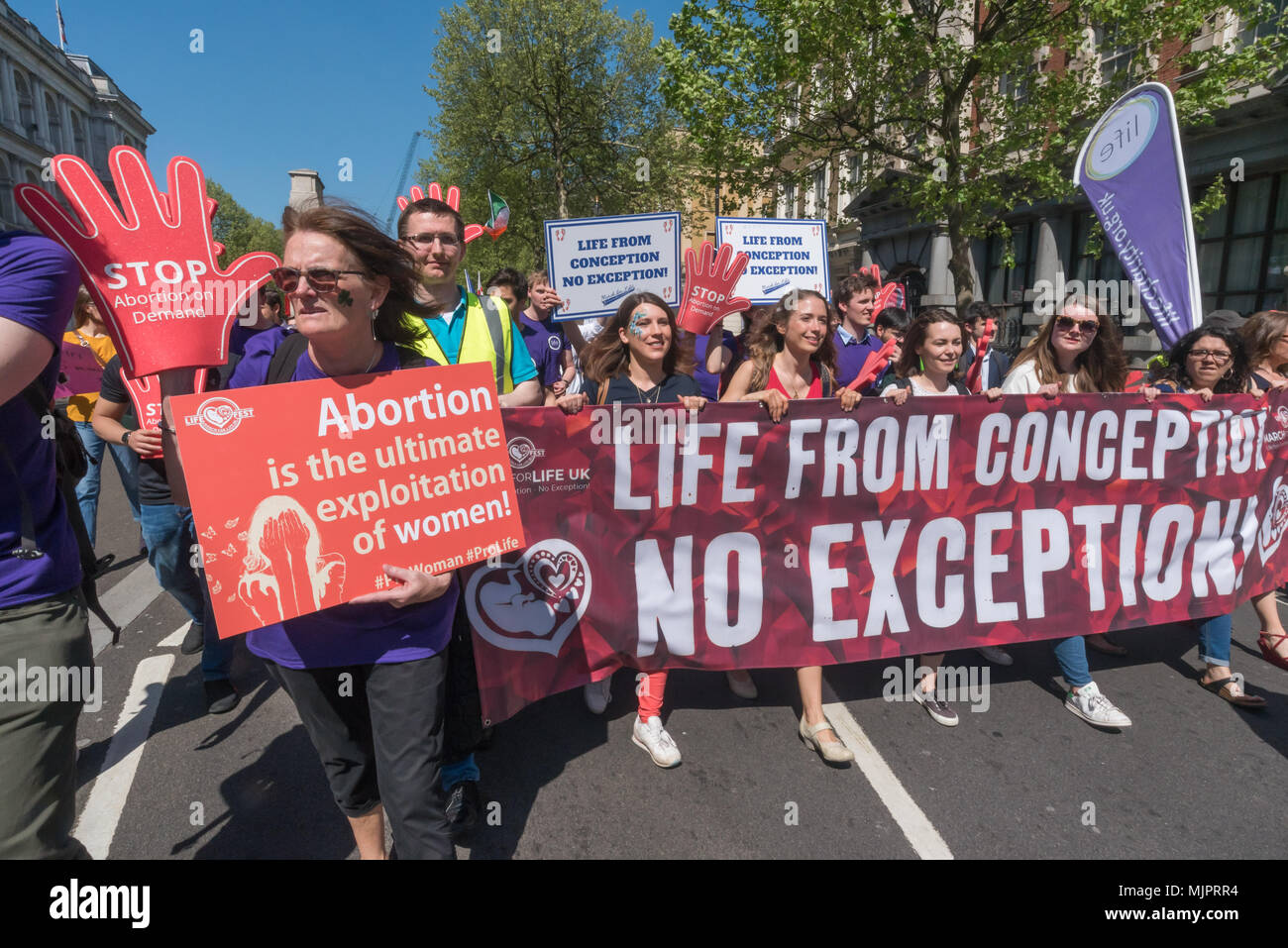 London, UK. 5th May 2018. The March for Life UK, a largely Catholic event calling for an end to abortions marches down Whitehall to a rally in Parliament Square. Opposed to abortion they aim to raise awareness of the hurt and damage that abortion causes and to unite all the pro-life groups in the UK to help bring to an end what it calls the greatest violation to human rights in history. Credit: Peter Marshall/Alamy Live News Stock Photo